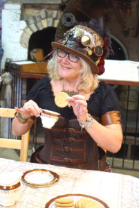 Steampunk lady dressed in a corset taking part in tea duelling